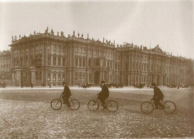 old photograph of bicycles crossing Palace Square, beside the Winter Palace (Hermitage)(St Petersburg)></div> </div>  <div id=
